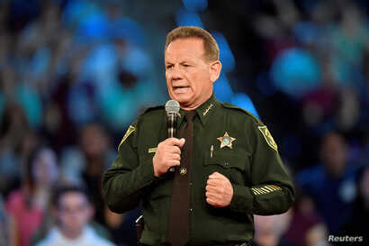 Broward County Sheriff Scott Israel speaks before the start of a CNN town hall meeting in Sunrise, Florida, Feb. 21, 2018. On Thursday, one of Israel's deputies resigned rather than face suspension for not engaging the gunman at Marjory Stoneman Doug