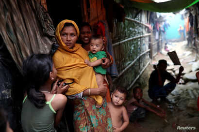 Rohingya refugees are seen outside their makeshift tent in the Kutupalong camp in Cox's Bazar, Bangladesh, Aug. 24, 2018.