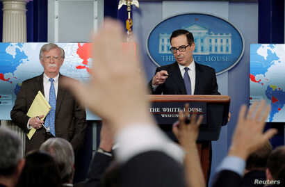 US Treasury Secretary Steven Mnuchin (R) and White House National Security Adviser John Bolton announce economic sanctions against Venezuela and the Venezuelan state owned oil company Petroleos de Venezuela (PdVSA) during a press briefing at the Whit...