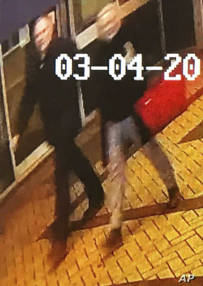 In this image taken from security camera footage from PA  shows a man and woman as they walk through an alleyway connecting a Zizzi's restaurant to a bench where  former Russian double agent Sergei Skripal was found in Salisbury on Sunday March 4, 20...