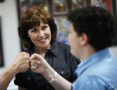 FILE - Jacky Rosen, left, attends an election night party, June 14, 2016, in Las Vegas. The U.S. representative is challenging Dean Heller in the Nevada Senate race.