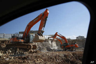 Work is under way on a new housing project in the West Bank settlement of Modin ilit, Jan. 1, 2019.