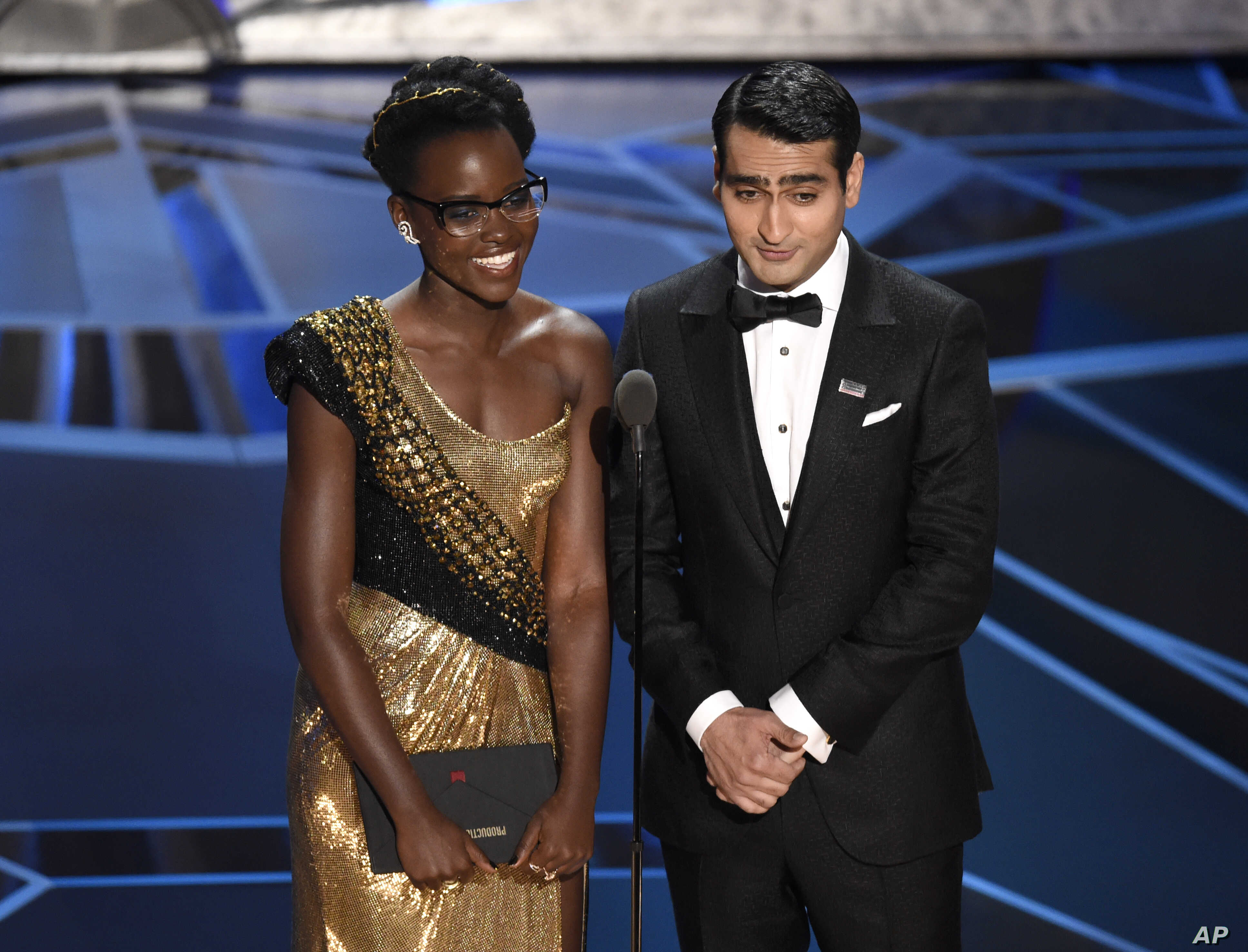 Lupita Nyong'o, left, and Kumail Nanjiani present the award for best production design at the Oscars, March 4, 2018.