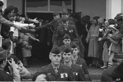 Kevin Hermening, second from front, was among the Marines held hostage in Iran. On their way home, they're shown leaving Wiesbaden Air Force hospital Jan. 25, 1981.