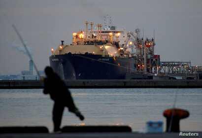FILE - A membrane-type liquefied natural gas (LNG) tanker is moored at a thermal power station in Futtsu, east of Tokyo, Feb. 8, 2017.