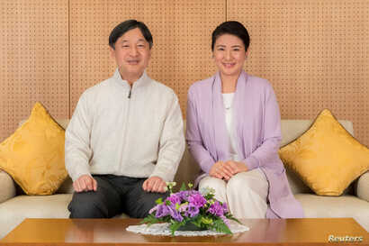 Japan's Crown Prince Naruhito, left, and Crown Princess Masako pose for a photo at their residence Togu Palace in Tokyo, Feb. 17, 2019.