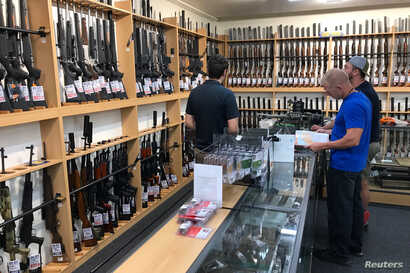 Firearms and accessories are seen on display at Gun City gunshop in Christchurch, New Zealand, March 19, 2019.