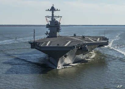 FILE - The USS Gerald R. Ford embarks on the first of its sea trials to test various state-of-the-art systems on its own power for the first time, from Newport News, Virginia, in an undated photo provided by the U.S. Navy.