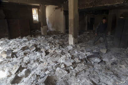 The remains of burned ancient books and manuscripts are seen inside Mosul's heavily damaged museum, March 8, 2017.