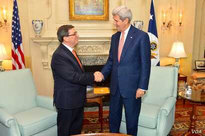 U.S. Secretary of State John Kerry shakes hands with Cuban Foreign Minister Bruno Rodríguez Parilla before their bilateral meeting at the U.S. Department of State in Washington, D.C., on July 20, 2015.