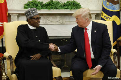 U.S. President Donald Trump meets with Nigeria's President Muhammadu Buhari in the Oval Office of the White House in Washington, U.S., April 30, 2018