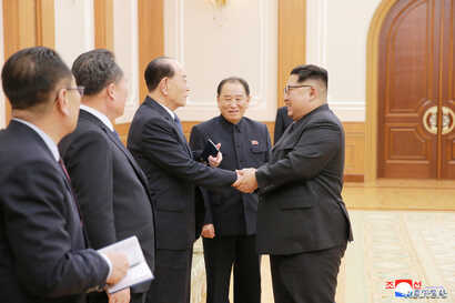 North Korean leader Kim Jong Un meets members of the high-level delegation of the Democratic People's Republic of Korea, which visited South Korea to attend the opening ceremony of the 23rd Winter Olympics in this undated photo released by North Kore...