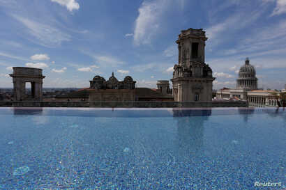 A historic building is seen from the rooftop infinity pool at the Gran Hotel Manzana, owned by the Cuban government and managed by Swiss-based Kempinski Hotels SA, in Havana, Cuba, May 12, 2017.