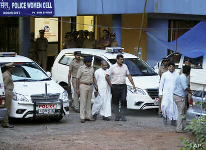 Bishop of the Indian city of Jalandhar, Franco Mulakkal, center, leaves after being questioned by police in Kochi, India, Sept. 19, 2018.