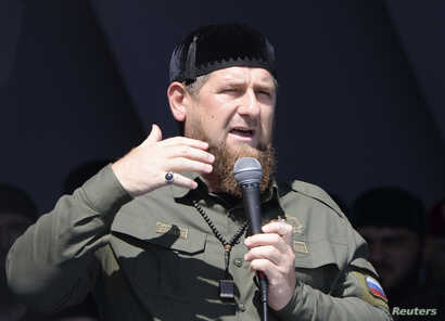 FILE - Head of the Chechen Republic Ramzan Kadyrov delivers a speech during a rally in support of Muslim Rohingya following the recent violence, which erupted in Myanmar, in the Chechen capital Grozny, Russia Sept. 4, 2017.