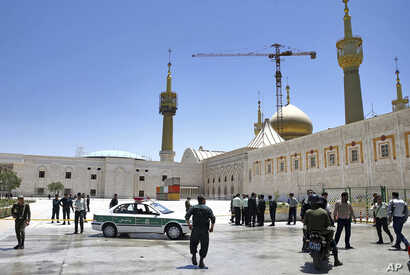Police officers patrol the scene, around the shrine of late Iranian revolutionary founder Ayatollah Khomeini, after an attack by several perpetrators in Tehran, Iran, June 7, 2017.