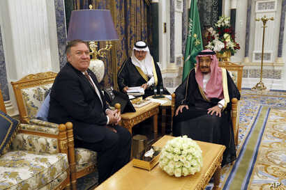 U.S. Secretary of State Mike Pompeo, left, meets with Saudi Arabia's King Salman in Riyadh, Saudi Arabia, Oct. 16, 2018.