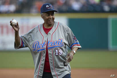 Former Negro League player and team owner Minnie Forbes throws out a ceremonial first pitch prior to a baseball  game  between the Detroit Tigers and Cleveland in Detroit,  July 1, 2017.