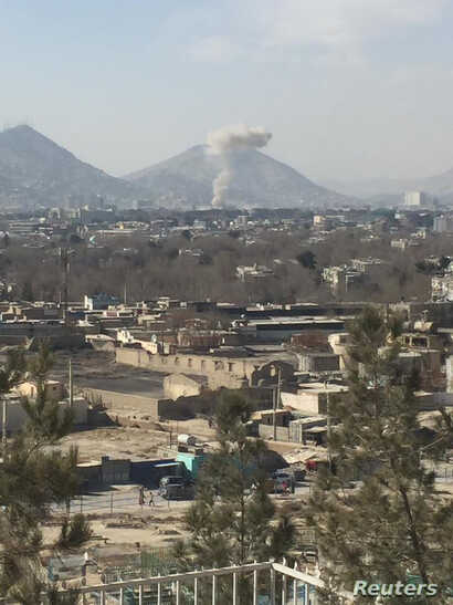 Smoke rises after a car bomb exploded in Kabul, Afghanistan, Jan. 27, 2018, in this image obtained from social media.