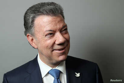 Colombian President Juan Manuel Santos poses for a portrait as he exits a Reuters Newsmaker conversation in Manhattan, New York, U.S., Sept. 21, 2016.