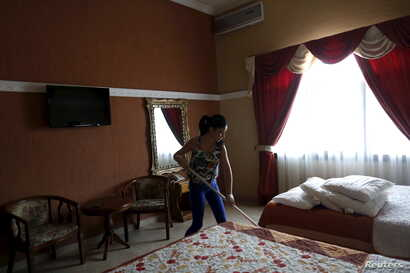 """Cuban migrant Erenia Gonzalez, 22, who ran out of money, works as cleaning lady at a hotel in Paso Canoas, Panama, on the border with Costa Rica, March 22, 2016. """"Since I was young I have always wanted to go to the U.S. to accomplish the American dre..."""