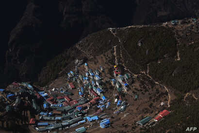 This photograph taken from a helicopter shows an aerial view of Namche Bazar in Nepal's Solukhumbu district on Nov. 22, 2018.