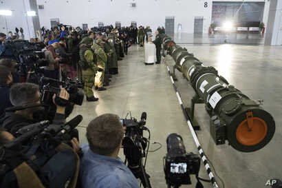 Foreign military attaches and journalists attend a briefing by the Russian Defense Ministry as the 9M729 land-based cruise missile, right, in Kubinka, Russia,  Jan. 23, 2019. The Russian military rolled out its new missile and spelled out its specifi