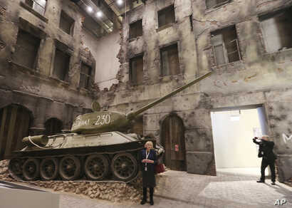A woman stands in front of an exhibit in the Museum of the Second World War, an ambitious new museum under creation for nine years has opened its doors for a day to historians, museums and reporters in Gdansk, Poland, Jan. 23, 2017.