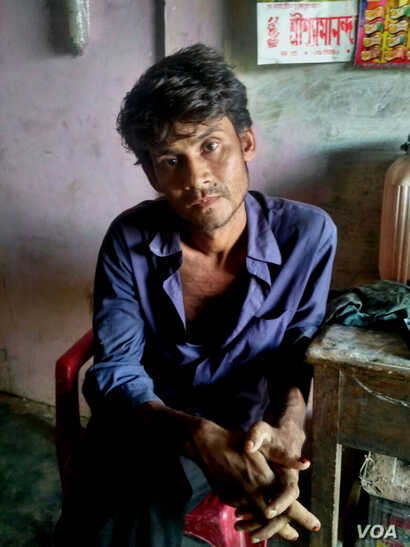 Hanif Khan, seemingly depressed, sits at his Kashipur village home in Cachar district of Assam a few days before he committed suicide on Jan. 1, 2018. He hanged himself hours after he found his name missing from the previous draft of NRC, published o...