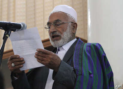 The father Farkhunda speaks at a hearing at the Primary Court in Kabul, Afghanistan, Wednesday, May 6, 2015.