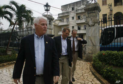 FILE - US Congressmen William Delahunt, D-Mass, Jeff Flake, R-Ariz., and  Jerry Moran, R-Kan. (L-R) arrive to Cuba's Foreign Ministry in Havana, Dec. 16, 2006.