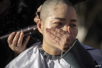 Li Wenzu has her head shaved to protest the detention of her husband and Chinese human rights lawyer Wang Quanzhang, detained during the 709 crackdown, in Beijing on Dec. 17, 2018.
