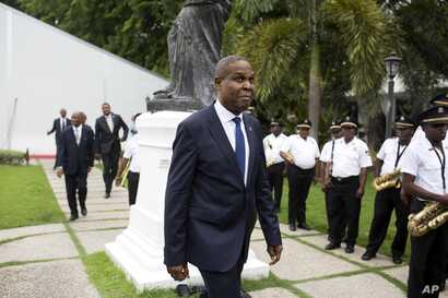 Haiti's prime minister Jean-Henry Ceant walks after his ratification ceremony at the national palace in Port-au-Prince, Haiti, Sept. 17, 2018.