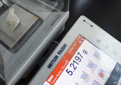 """The drug """"gray death"""" is weighed at the crime lab of the Georgia Bureau of Investigations in Decatur, Ga., May 4, 2017. The new and dangerous opioid combo underscores the ever-changing nature of the U.S. addictions epidemic."""
