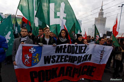 Far-right protesters march during the annual far-right rally, which coincides with Poland's National Independence Day in Warsaw, Poland, Nov. 11, 2014.