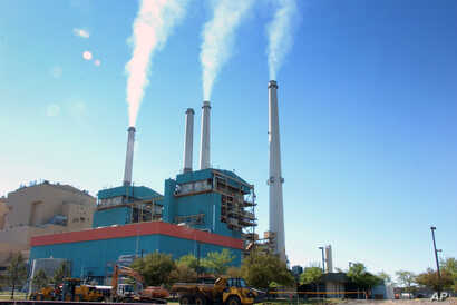 FILE - Smoke rises from the Colstrip Steam Electric Station, a coal burning power plant in in Colstrip, Mont.