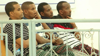 Defendants Abdiweli Ahmed Diriye, Abdul Abdi Warsame, Hassan Aden Isak, and Mukhtar Mohamud Hassan appear before a military tribunal in Mogadishu, Jan. 1, 2018, in connection with the Oct. 14 truck bombing in Mogadishu that killed 512 people.