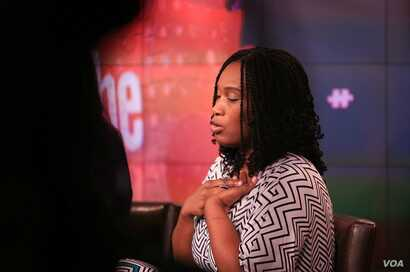 """Morenike Giwa Onaiwu of the Autism Women's Network clasps a """"stimming"""" device while on the panel."""