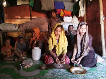 Noor Ankis at her Balukhali Rohingya refugee camp in Cox's Bazar, Bangladesh, along with her husband and five children, after she fled Myanmar in September.