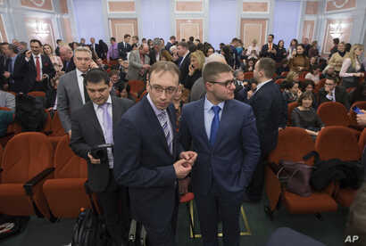 Members of Jehovah's Witnesses wait in a court room in Moscow, Russia, April 20, 2017. Russia's Supreme Court has banned the Jehovah's Witnesses from operating in the country.