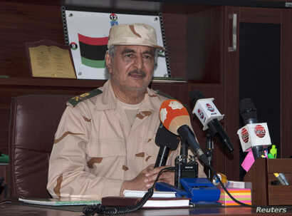 FILE - Ex-general Khalifa Haftar speaks during a news conference after surviving an assassination attempt in Al Marj, east of Benghazi, Libya, June 4, 2014.