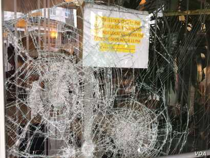 The Hilton Garden Inn is one of the many buildings that suffered broken windows as a result of Wednesday night's violent protests in Charlotte, N.C., Sept. 22, 2016.