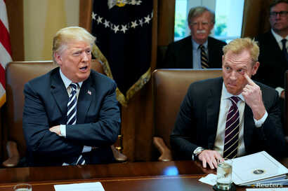 U.S. President Donald Trump, flanked by Deputy Secretary of Defense Patrick Shanahan, holds a cabinet meeting at the White House in Washington, U.S. May 9, 2018.