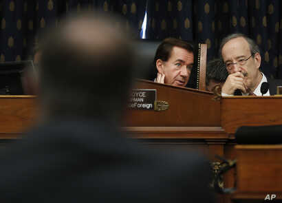 Chairman Rep. Ed Royce, R-Calif., center, talks with Ranking Member Rep. Eliot Engel, D-NY., right, as they listen to testimony by Secretary of State Mike Pompeo, left, at the House Foreign Affairs Committee hearing on Capitol Hill in Washington, May...