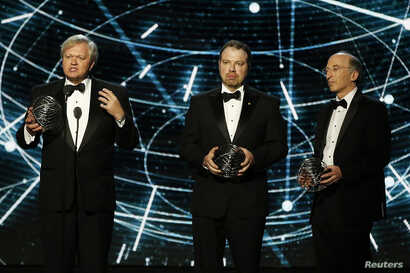 Lrom left, Fundamental Physics co-laureates Brian P. Schmidt, Adam G. Riess, and Saul Perlmutter speak on stage during the 2nd annual Breakthrough Prize Award in Mountain View, California, Nov. 9, 2014.