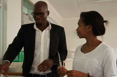 GAIA scholar Patrica Siyabu (R) shares a light moment with GAIA projects Officer Chimwemwe Mwangonde at Queen Elizabeth Central Hospital i Blantyre, Malawi. Siyabu says that for now she is committed to staying in a public hospital. (L. Masina/VOA)