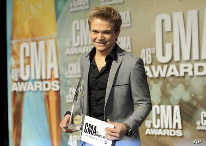 Hunter Hayes poses backstage with the new artist of the year award at the 46th Annual Country Music Awards at the Bridgestone Arena on Nov. 1, 2012, in Nashville, Tenn.