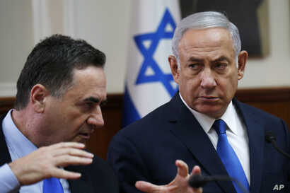 FILE - Israeli Prime Minister Benjamin Netanyahu listens to then-Transportation and Intelligence Minister Yisrael Katz during the weekly Cabinet meeting at the Prime Minister's office in Jerusalem, Sept. 5, 2018.