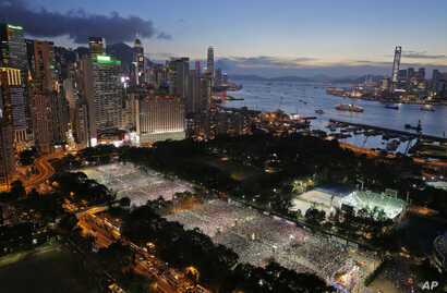 Tens of thousands of people attend a candlelight vigil at Victoria Park in Hong Kong to mark the 25th anniversary of crackdown in Tiananmen Square, June 4, 2014.