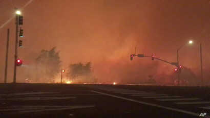 In this image from video released by Chase Bonefant @ChaseBonenfant, shows the Lilac fire burning in Bonsall, Calif. A brush fire driven by gusty winds exploded rapidly Thursday north of San Diego, destroying dozens of trailer homes in a retirement c...